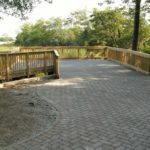 stone patio with wooden deck